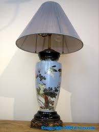 anese porcelain lamp with bird and fl design and an urn shape