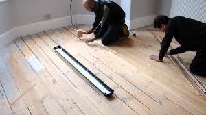 fill gaps wood floor sawdust