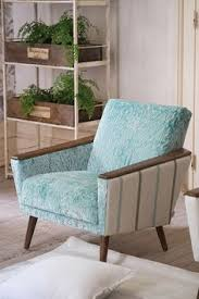 rack w plants in wooden crates designers guild wedge chair