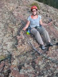 Alyce Smith examines my handy Chicken Head Anchor on the FA of Tradventure  (5.9) in Devils Head, CO.