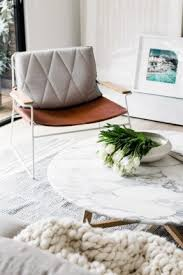 Marble Coffee Table, Leather Chair, Chunky Blanket.