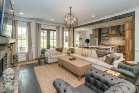 living room chandelier orb transitional with french doors brick fireplace surround mid century modern