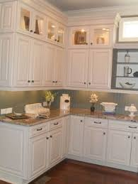 Small Picture Make a Small Kitchen Look Larger Cabinet trim Gray green and