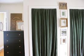 Closet door curtain track