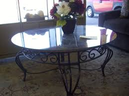 furniture round glass top table and black wrought iron base on areas rug modern