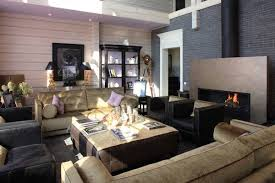 Modern interior decorating accentuated with hydrangea flower arrangement,  living room design with contemporary fireplace ...
