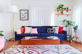 view in gallery deep blue sofa fills the living room with cheer design taylor taylor