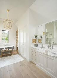 washstand bathroom pine:  from a sloped shiplap ceiling over pine wood floors framing marble accent tiles this gray and white master bathroom features a light gray washstand