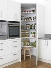 Corner Pantry- like this idea for a kitchen remodel. Corner cupboard floor  to ceiling instead of the wasted counter space in the middle we have no