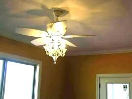 how to hang a heavy chandelier ceiling fan with crystals white chandelier 4 light kit s