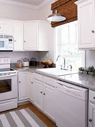 Amazing White Kitchen Appliances Disappear Against Coordinating White Cabinets.  Classic Granite