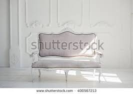 white vintage couch. White Textile Classical Style Sofa In Vintage Room. Background. Couch