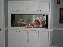 find quality aquarium furniture. We Can Build You An In Wall Aquarium, Or Free Standing. Our Cabinetry Is Of The Highest Quality And Be Designed To Match Your Existing Cabinets. FIND US Find Aquarium Furniture