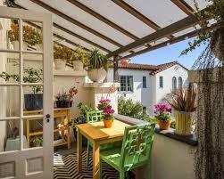 Balcony container garden - mediterranean balcony container garden idea in  San Francisco with a roof extension
