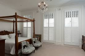 plantation shutters indoor victory white thomastown wrought iron fireplace doors underwood john lewis ready made blinds