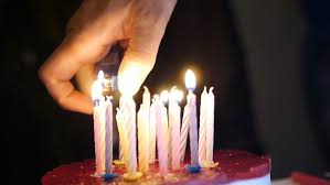hand lighting a birthday candle on cake stock footage 21652222 shutterstock