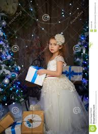 A 5 year old girl in the studio with Christmas decorations of gifts Little Girl Near With Presents Stock Photo - Image