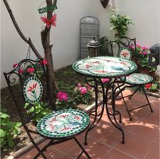 round glass top patio garden table and