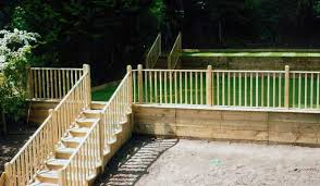 wooden steps and handrail leading turfed lawn with barades