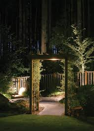 inviting guests in to your kansas city backyard is easy when you have a pergola nicely lit in the middle of your landscaping that comes to life at night