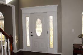 Image Entryway Inside Front Door Crown Molding Painted White And Door From Home Depot W Side Lights The Frugal Homemaker Inside Front Door Crown Molding Painted White And Door From Home
