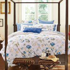 Floral Bed Linen Pillows And Wooden Headboard For A Country Style Country Style Bed