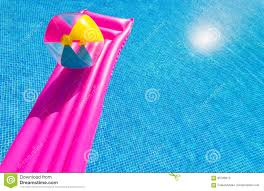 swimming pool beach ball background. Pink Air Bed And Beachball On Swimming Pool Beach Ball Background
