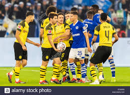 Gelsenkirchen, Germany 08 december 2018 Soccer Bundesliga: Schalke 04 v  Borussia Dortmund l+r fighting in Ruhrpot Derby Stock Photo - Alamy