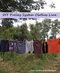 how to make your own strong clothes line using a pulley system diy pulley system clothes line the decorative clothesline