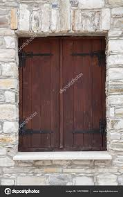 closed wooden window shutters stock photo