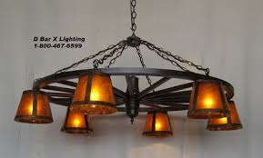 ww022 42 6 rustic wagon wheel chandelier light fixture 42 inch dia with 6 downlights shown with glass shades shades sold separately