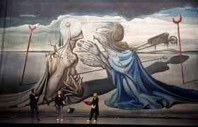 daniele finzi pasca in front of the tristan backdrop