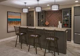 basement bar lighting ideas home bar transitional with wine rack top interior designer omaha pendant lights over bar
