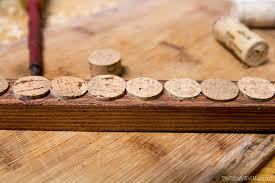 using recycled materials like ss of wood and wine corks you can make a handy