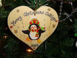 penguin in hat scarf wooden heart hanger decoration personalised handcrafted unique