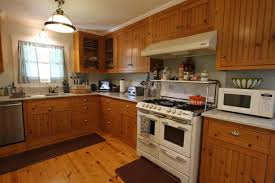 Light Wood Flooring Texture Dark Cabinets With White Appliances