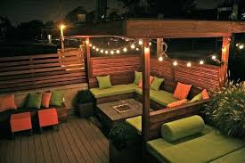 elegant outdoor strand lighting and modern backyard ideas with wooden deck using decorative outdoor string lighting