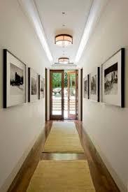 lighting for hallways. I Like The Hallway Art, Art Deco Style Lights, Glass Open Doorway To A Beautiful Garden Lighting For Hallways