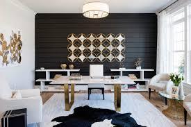 dark wall freestading desk open shelves rug area wooden floor white armchair wall decoration glass rounded