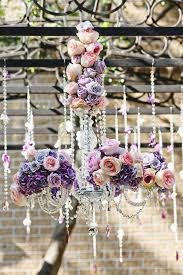 they look amazing as a focal point on a tented reception or ceremony plus adding flowers to your venue s chandeliers are a great way