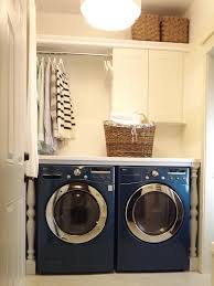 laundry furniture. Simple Laundry Organizing Storage Feat Blue Gloss Front Loader Washing Machine Shelf With White Cabinet And Clothes Bar Furniture
