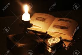 candle clock and an old book stock photo 10327193