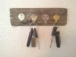 DIY Key Holder Using Old Keys. Here is another opinion regarding DIY key  holders.