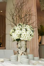 Daisies and Branches in white birch= fab centerpiece. Liking the flowers  and branches.