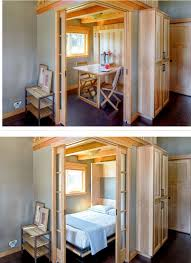 living room with bed: murphy bed fold up table in a  sq ft park model home in