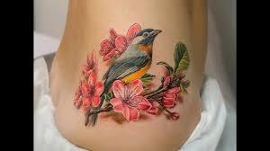татуировка перо с птицами значение у девушек