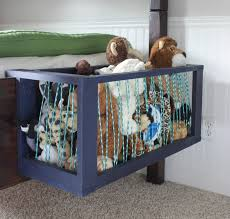 Build one of these toy corrals to attach to the end of your child's bed.