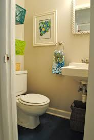 simple small bathroom decor light cream walls white bathroom fixtures small framed wall picture black