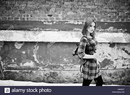 An outdoor portrait of a young pretty girl with red hair wearing