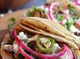 adobo beef tacos with pickled red onions